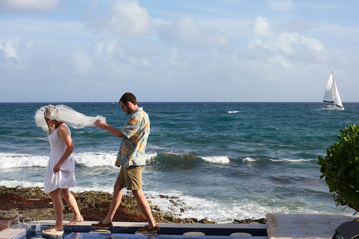 ocean boat people walking carrying white fabric, wedding preparation, Casa La Roca, Puerto Aventuras,