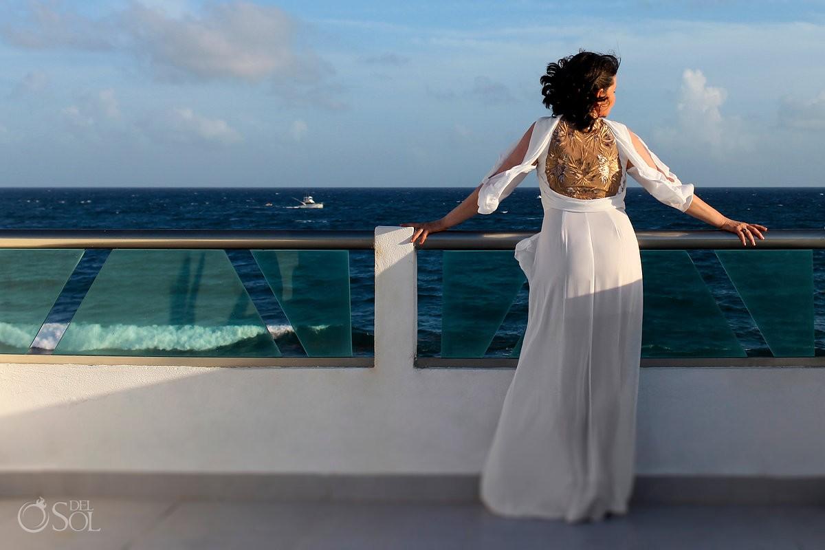bride looking ocean boat, Casa La Roca, Puerto Aventuras,