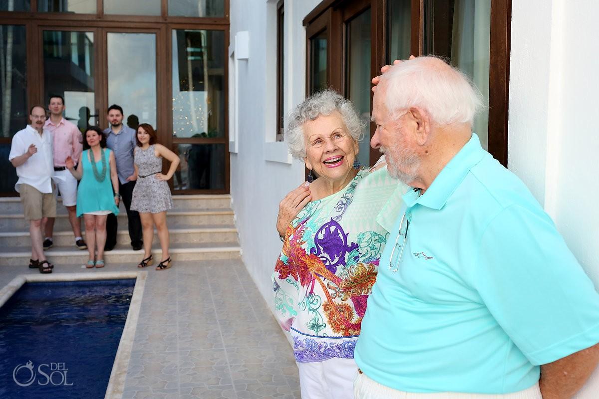 grandma touching grandpa laughing, Casa la Roca Family Portraits, Puerto Aventuras