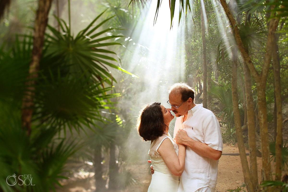 light rays jungle, couple kiss, artistic wedding photograph, Cenote Trash the Dress, Riviera Maya, Mexico