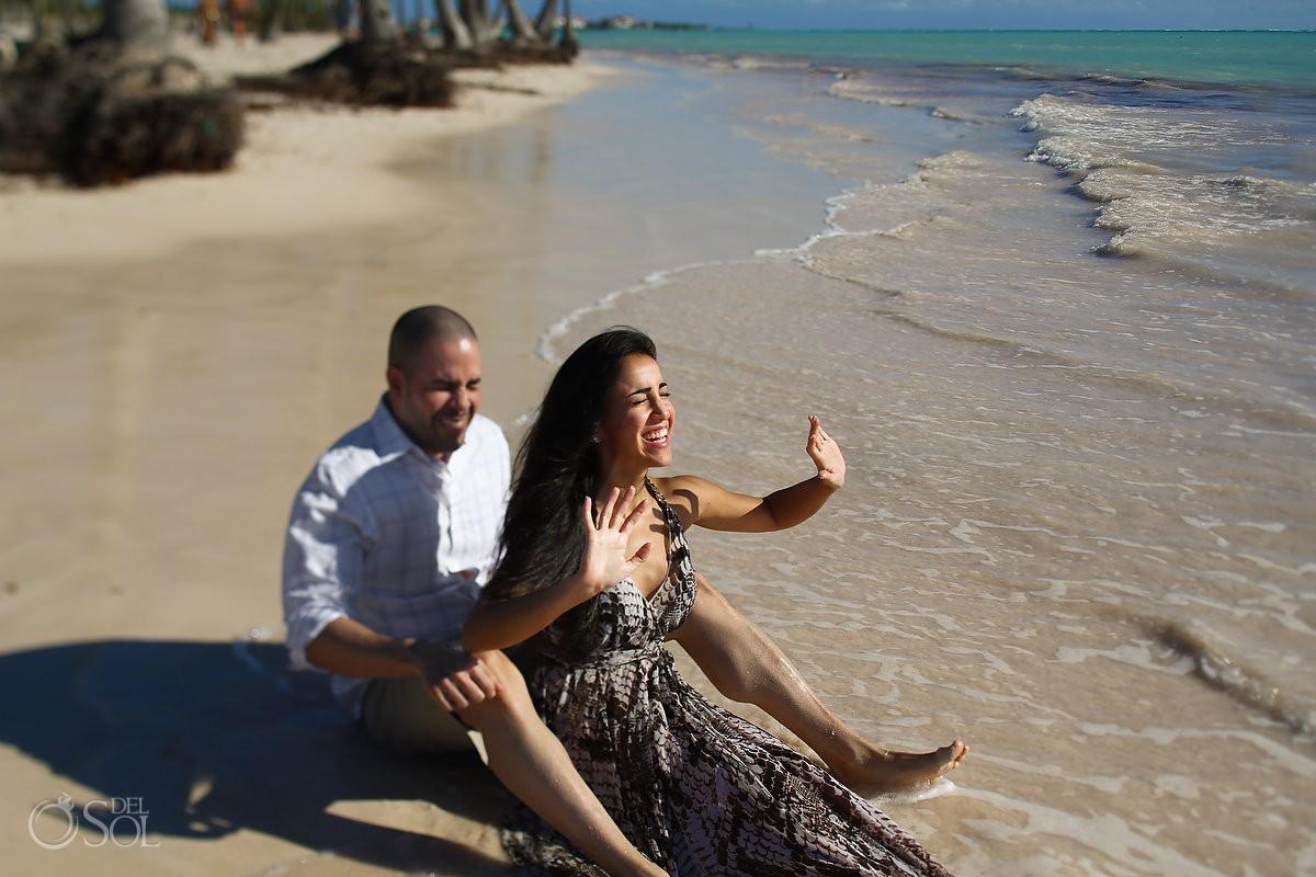couple sitting laughing, Carribean Beach portraits, blue sky palm trees, Sanctuary Cap Cana Resort, Dominican Republic