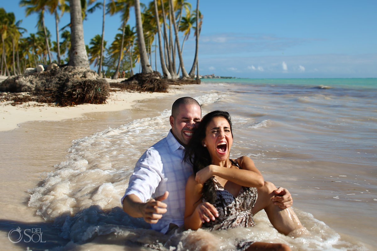 couple sitting laughing wave, Carribean Beach portraits, blue sky palm trees, Sanctuary Cap Cana Resort, Dominican Republic