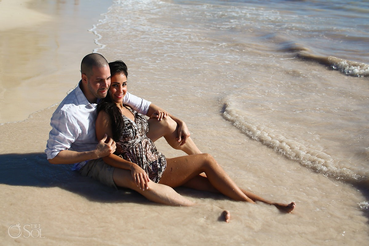 couple sitting ocean, Carribean Beach portraits, blue sky palm trees, Sanctuary Cap Cana Resort, Dominican Republic