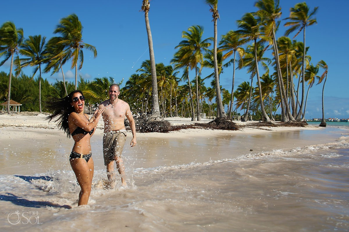 couple bikini dancing ocean, Carribean Beach portraits, blue sky palm trees, Sanctuary Cap Cana Resort, Dominican Republic