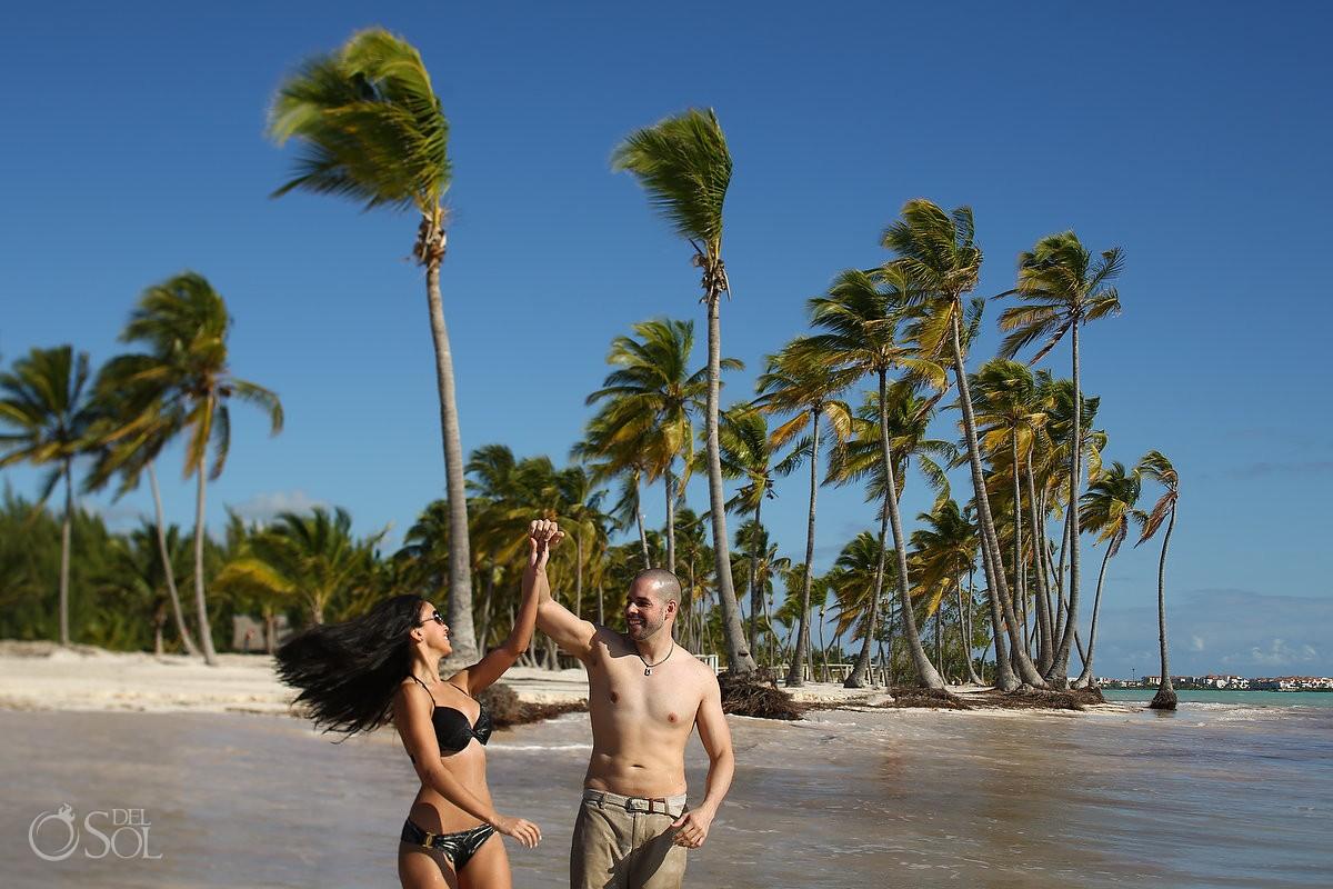 couple dancing swimsuits ocean, Carribean Beach portraits, blue sky palm trees, Sanctuary Cap Cana Resort, Dominican Republic