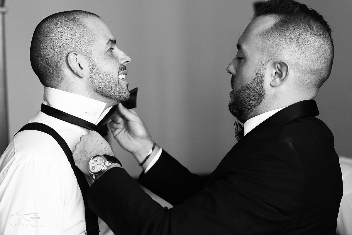 groom groomsman getting ready adjusting tie black white monochrome