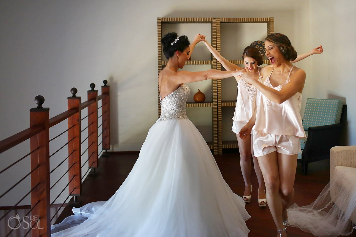 bride happy dancing bridesmaids getting ready Dennis Basso wedding dress, Sanctuary Cap Cana Resort, Dominican Republic