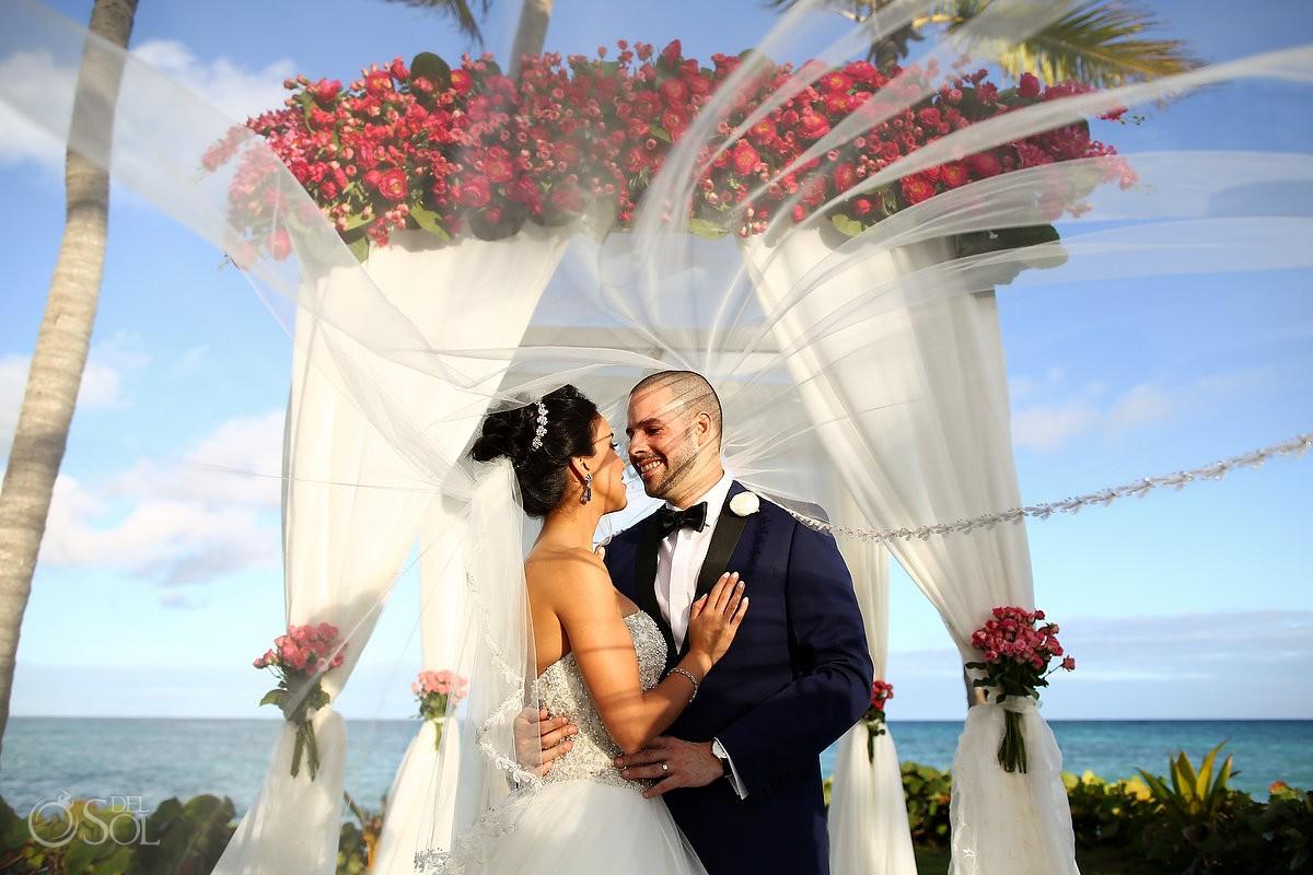 creative wedding portrait veil movement, bride groom under pink flower chuppa gazebo, Sanctuary Cap Cana Resort, Dominican Republic
