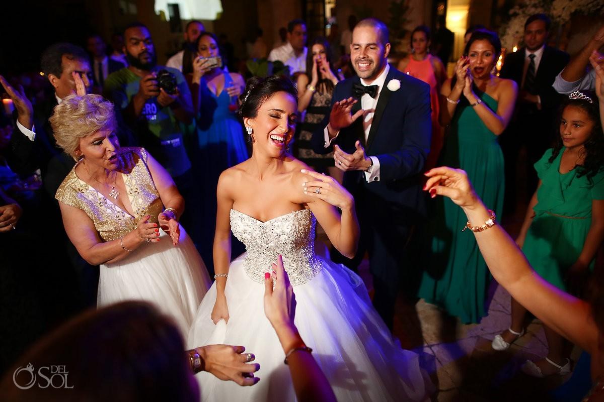 bride wearing Dennis Basso dress Persian dancing, wedding reception, Sanctuary Cap Cana Resort, Dominican Republic