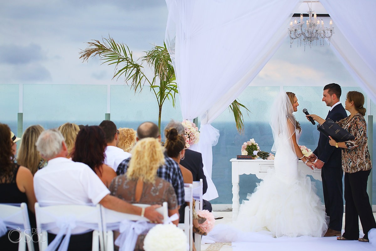 bride and groom say vows on sky deck at Beach Palace, Cancun, Mexico