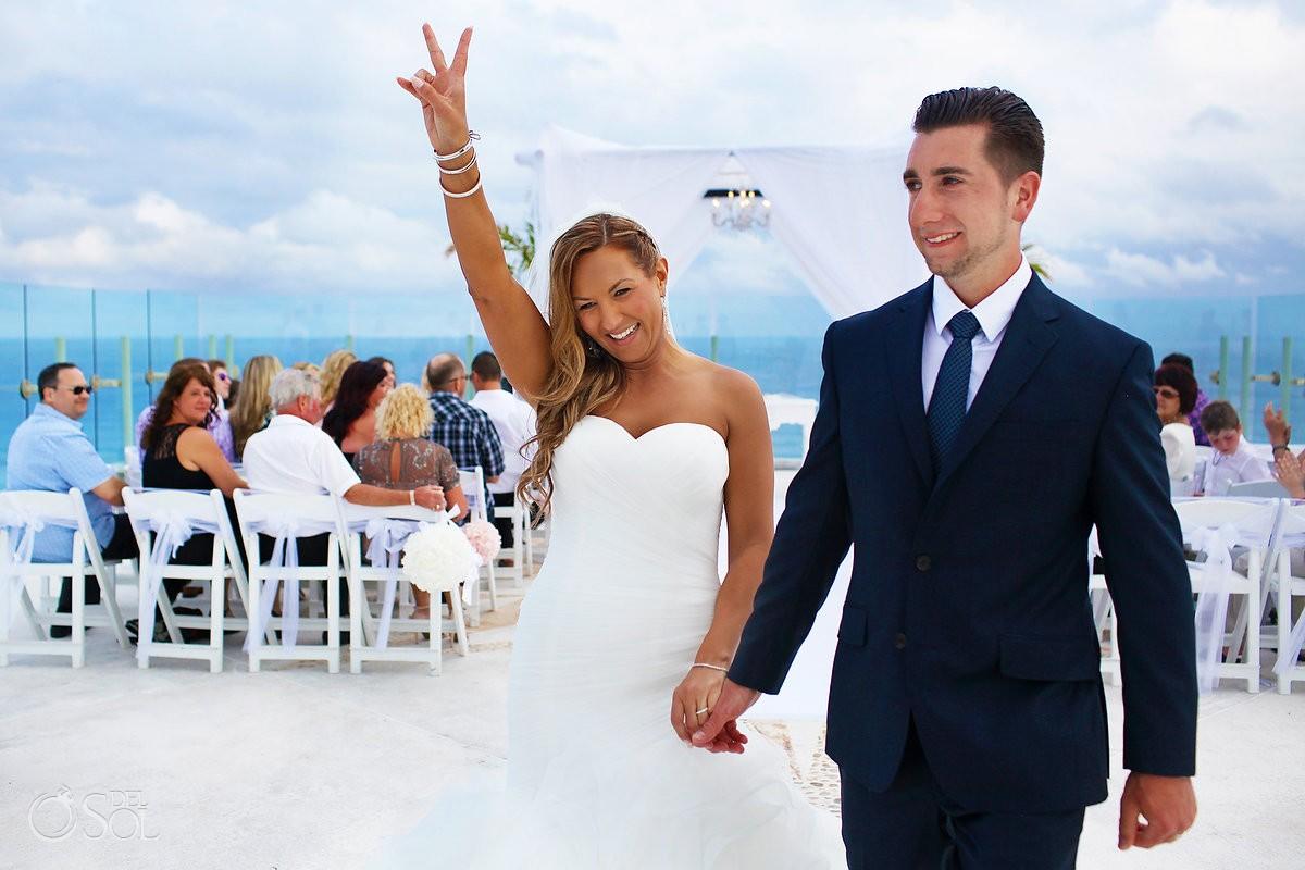 destination wedding recessional peace sign happy bride and groom