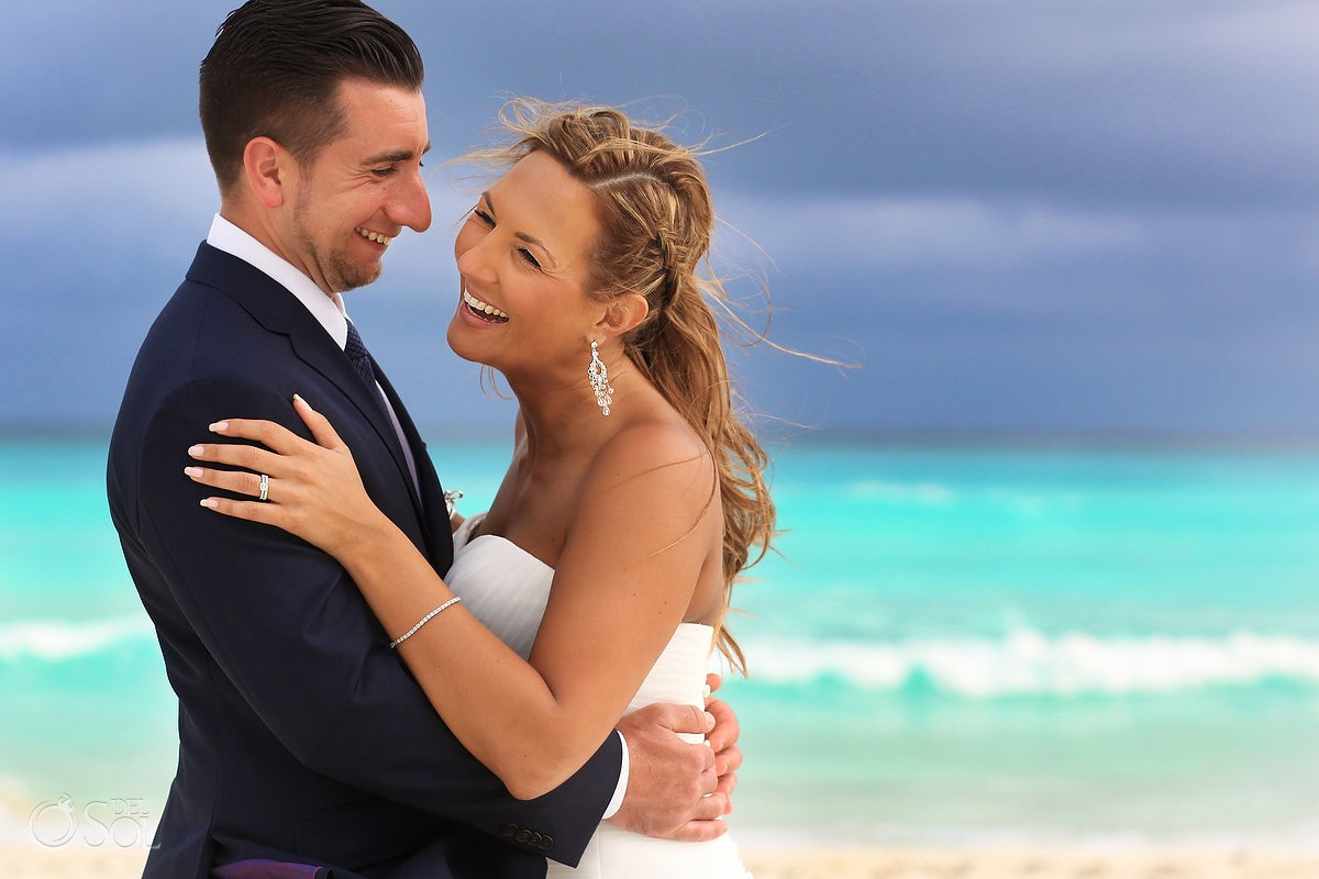 laughing bride and groom beach portrait at Beach Palace, Cancun