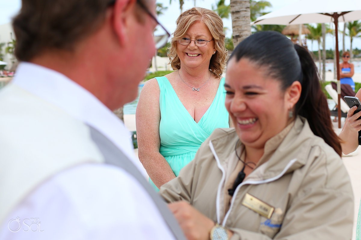 Wedding coordinator fixing boutonnier mom smiling, Wedding Secrets Akumal, Riviera Maya, Mexico