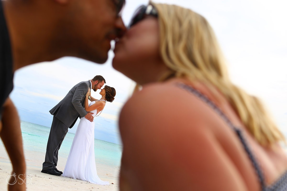 fun creative wedding portrait couple kissing framed in kiss, beach Wedding at Secrets Akumal, Riviera Maya, Mexico