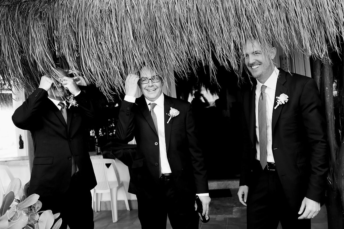 funny wedding picture groomsmen with palapa on heads, Hacienda Del Secreto, Riviera Maya, Mexico