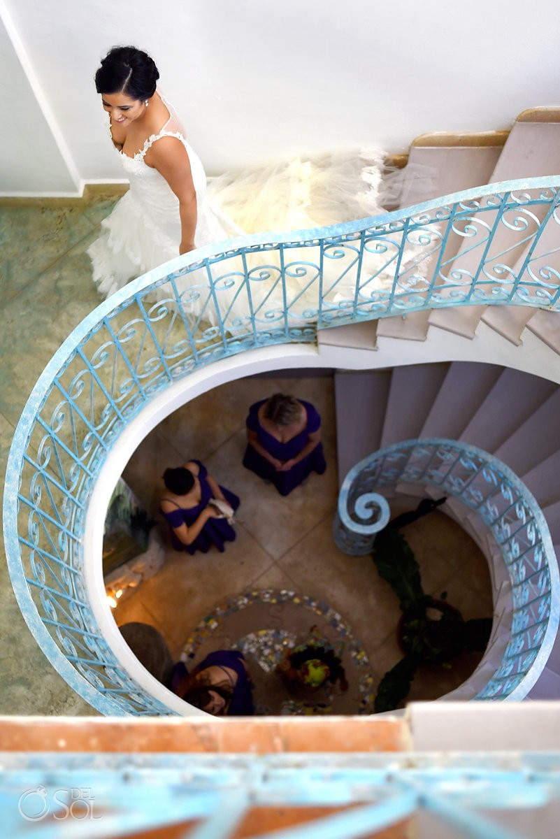 Beautiful wedding photo bride walking down blue spiral staircase, Hacienda Del Secreto, Riviera Maya, Mexico