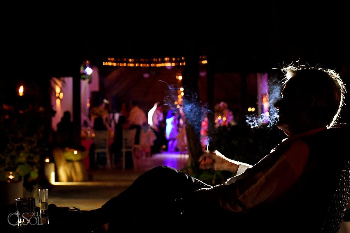cigar smoking, palapa jack, Wedding reception Hacienda Del Secreto, Riviera Maya, Mexico