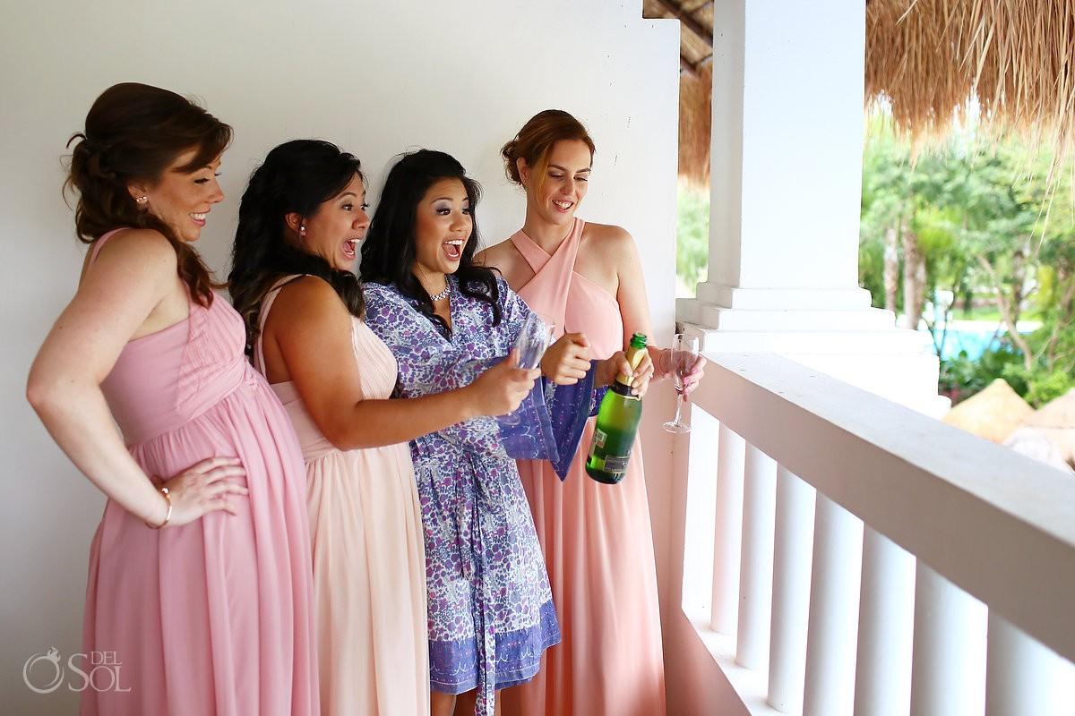 getting ready bride bridesmaids opening champagne, Rain Wedding Hotel Grand Sunset Princess, Playa del Carmen, Mexico
