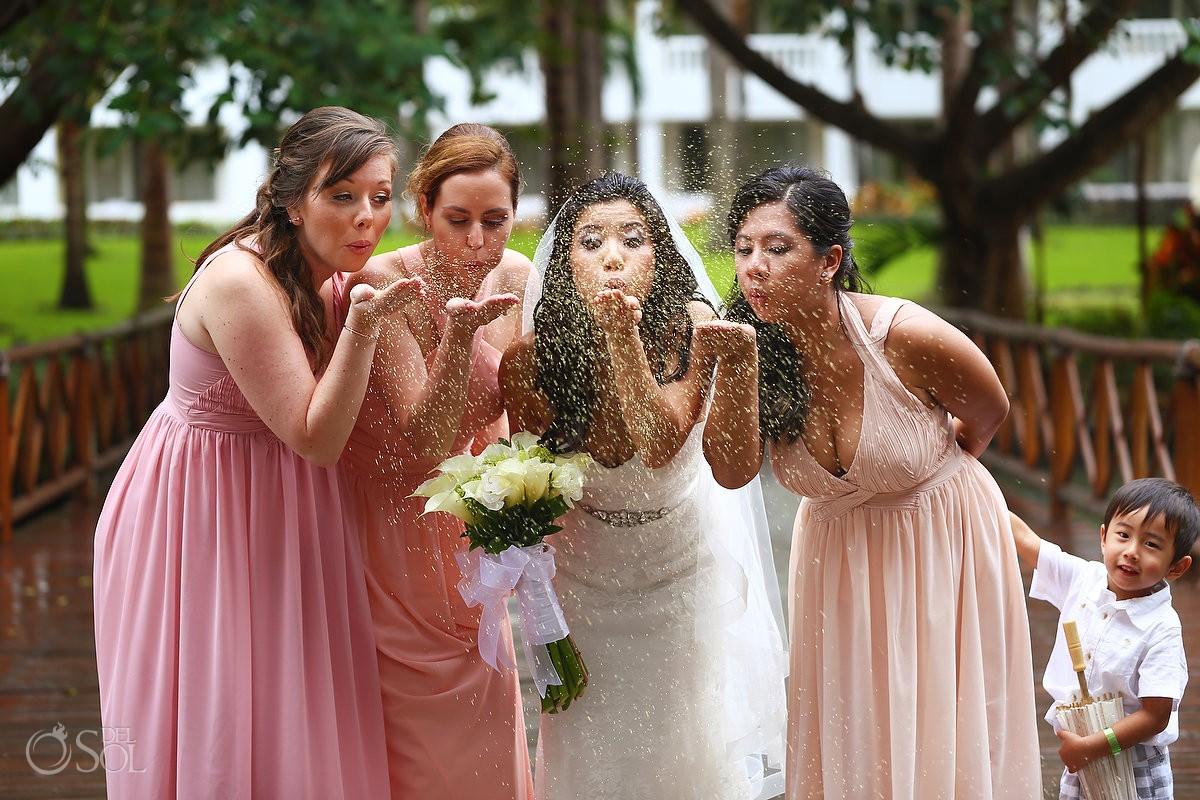 bride bridesmaids blowing glitter cute kid, Rain Wedding Hotel Grand Sunset Princess, Playa del Carmen, Mexico