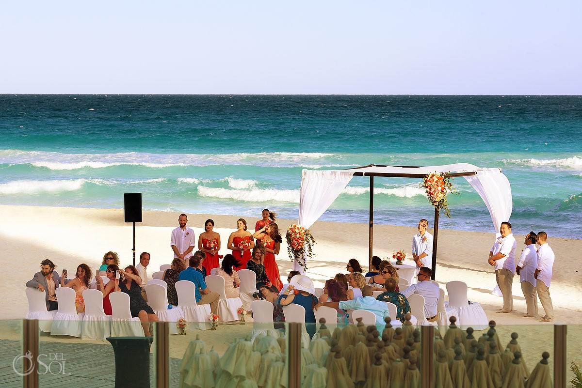beach destination wedding ceremony at Me Cancun Hotel Cancun