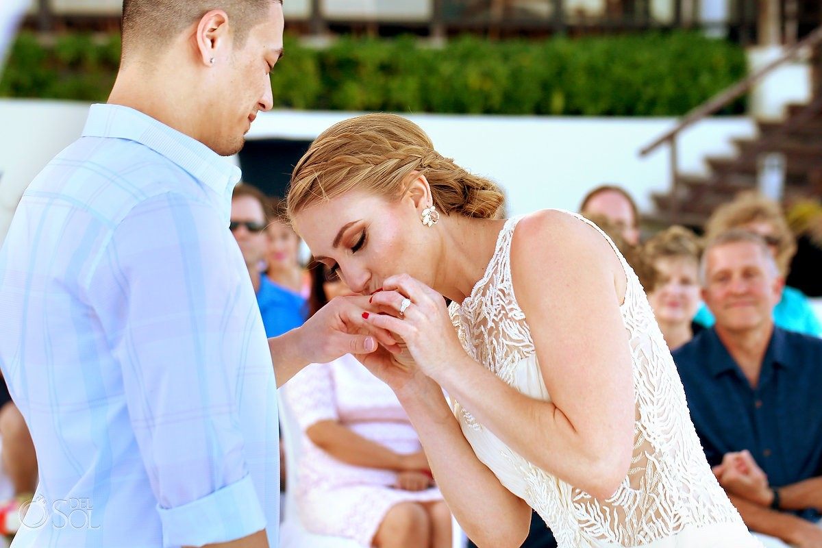 bride kissing wedding ring at Melia Me hotel cancun