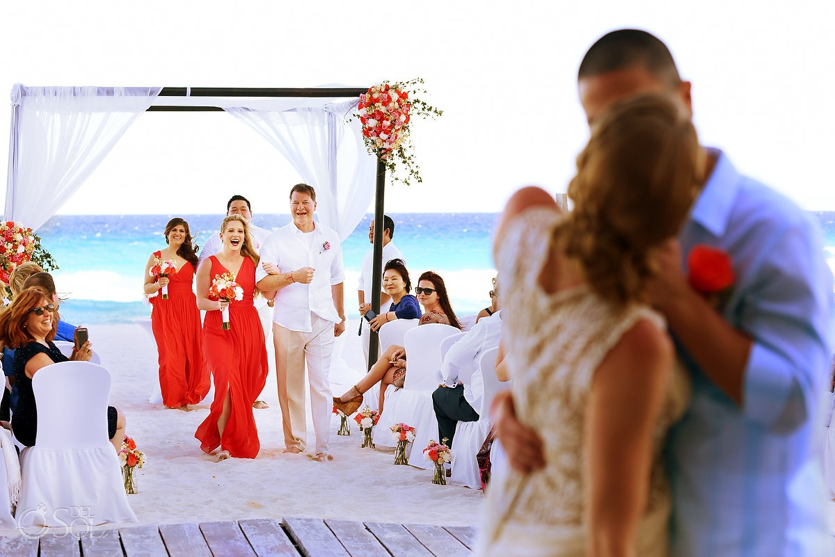 Bride and groom kiss at destination beach wedding at Melia Me Hotel cancun