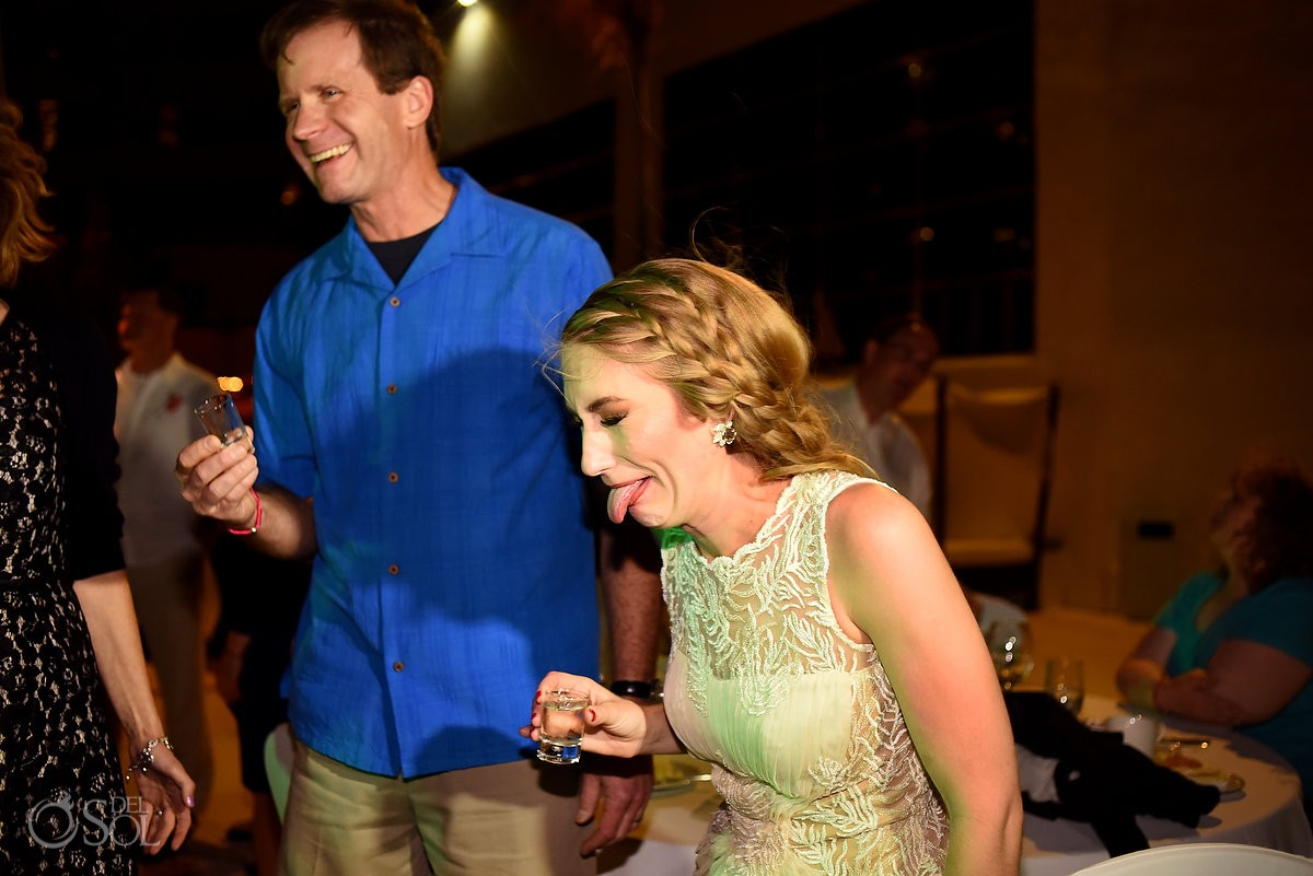 bride tasting tequila at her mexico destination wedding