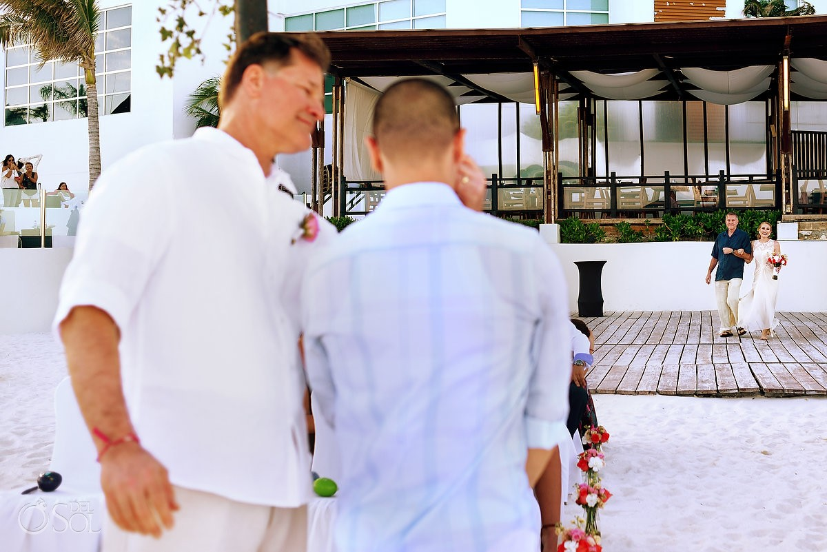 groom crying during destination wedding processional at melia cancun hotel