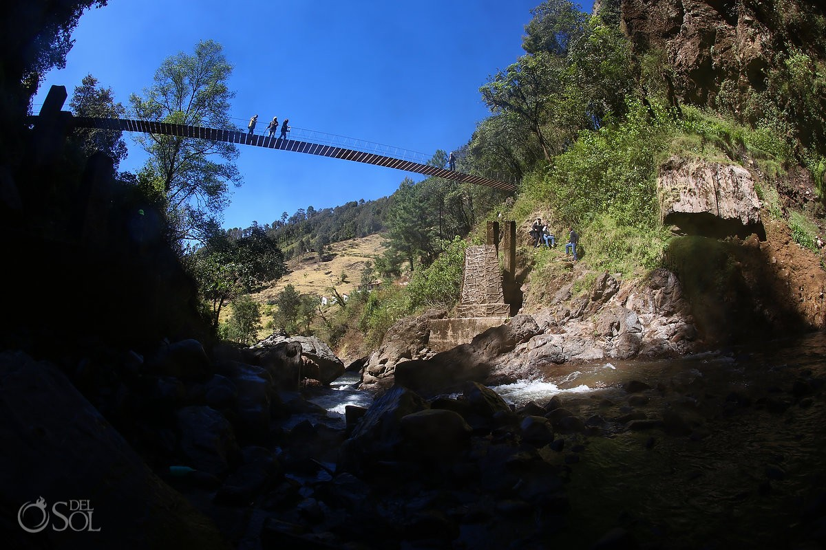 Travel photography, high rope bridge over river Michoacan