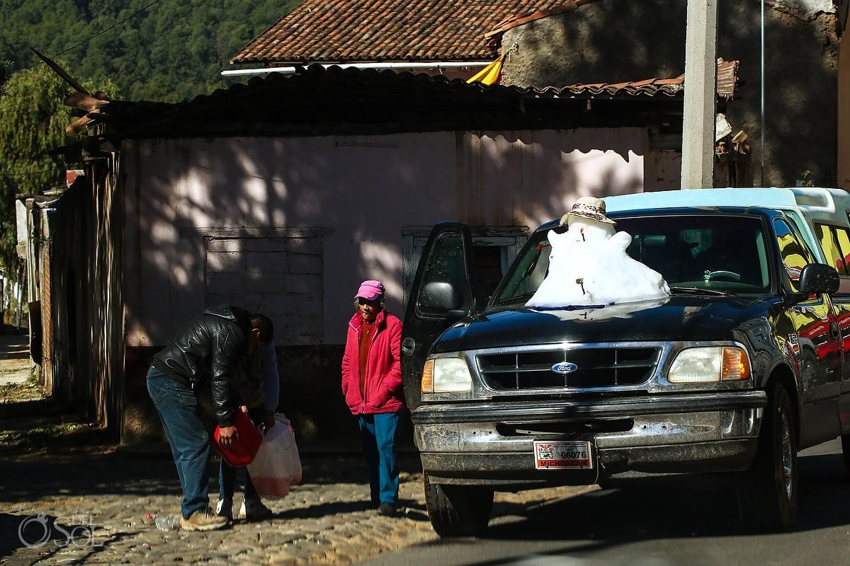 Travel documentary photography, snowman on car Michoacan