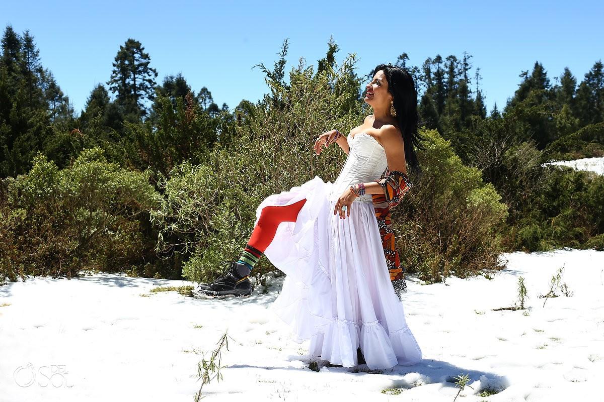 Sol Tamargo wearing white Claudia Bo corset skirt red stockings mountain snow Michoacan