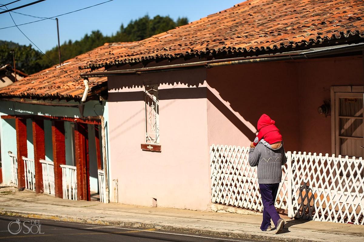 kid piggy back showing butt crack, street photography Michoacan