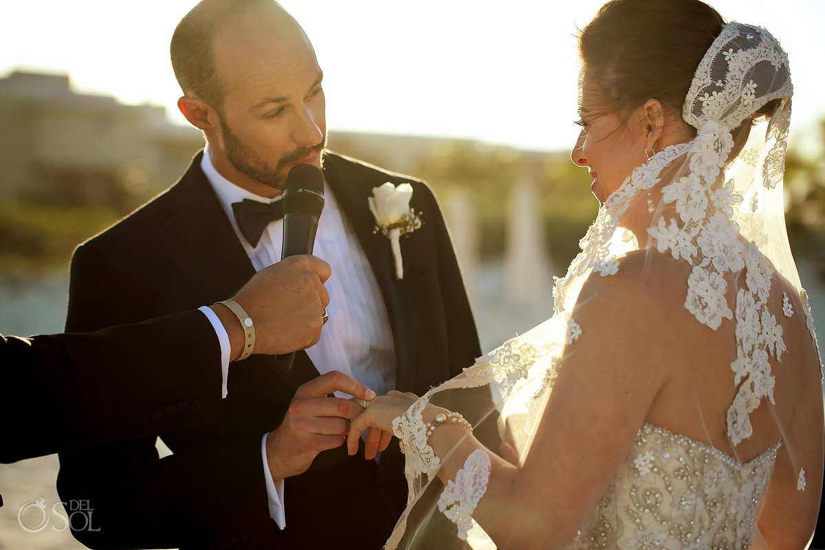 ring exchange beautiful light beach wedding Moon Palace, Cancun, Mexico