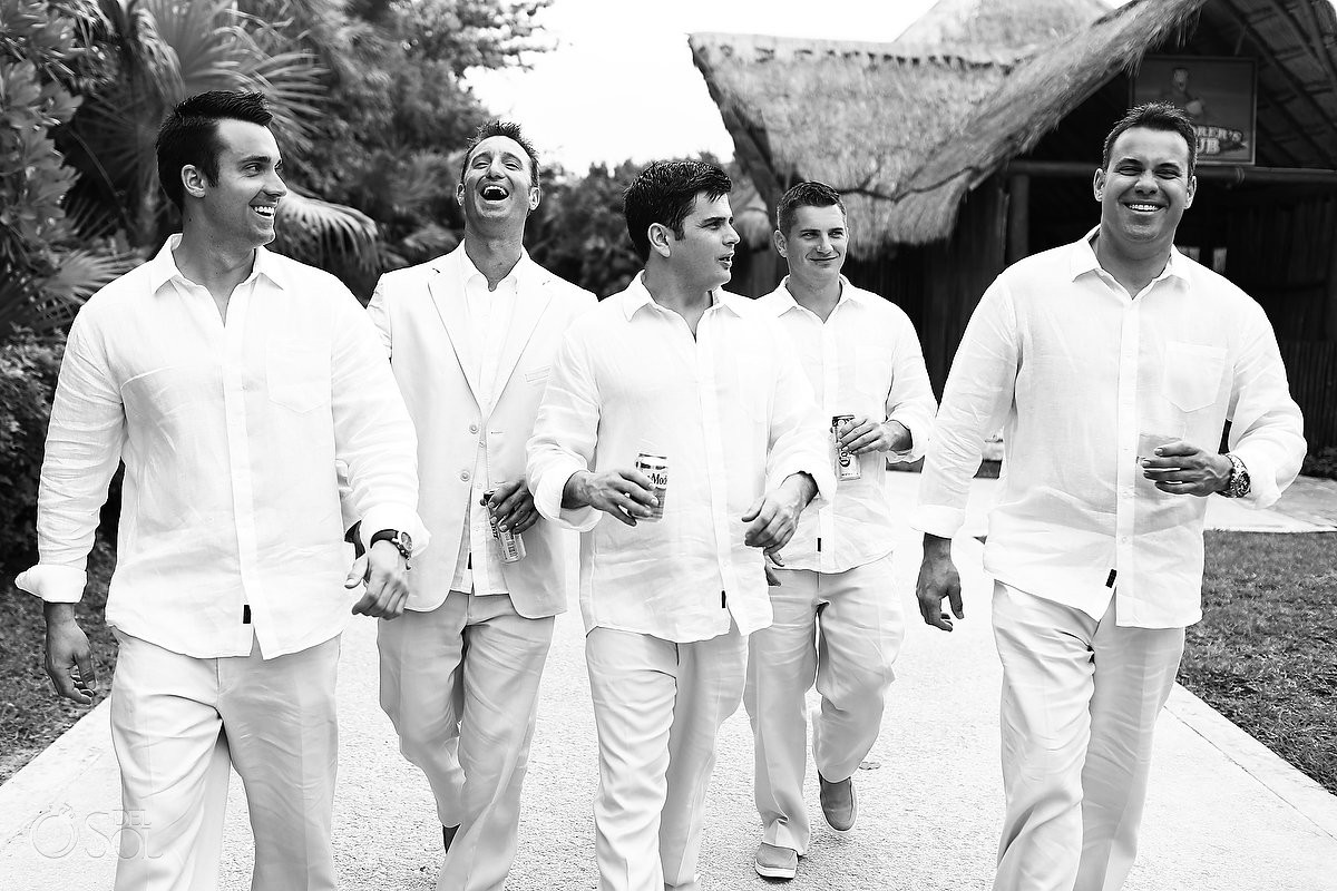 cool candid groomsman picture walking laughing black white, Now Sapphire Beach Wedding