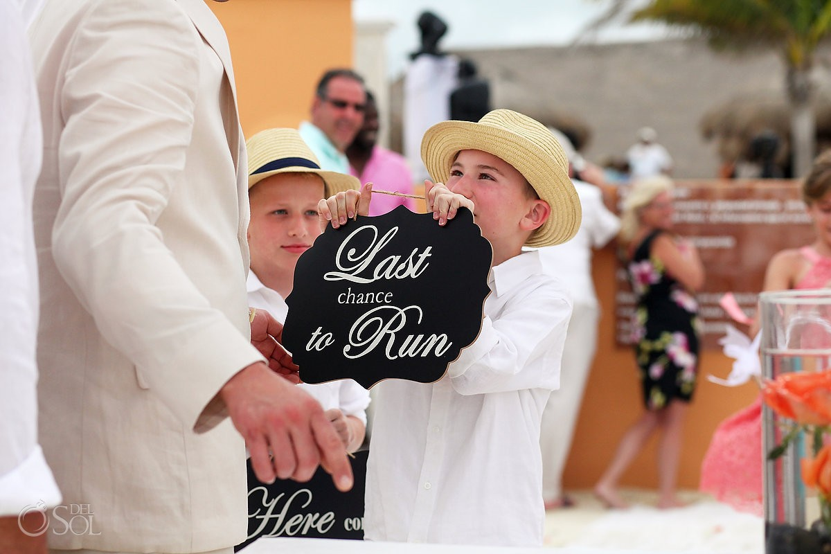 funny wedding photo, ring bearer shows groom