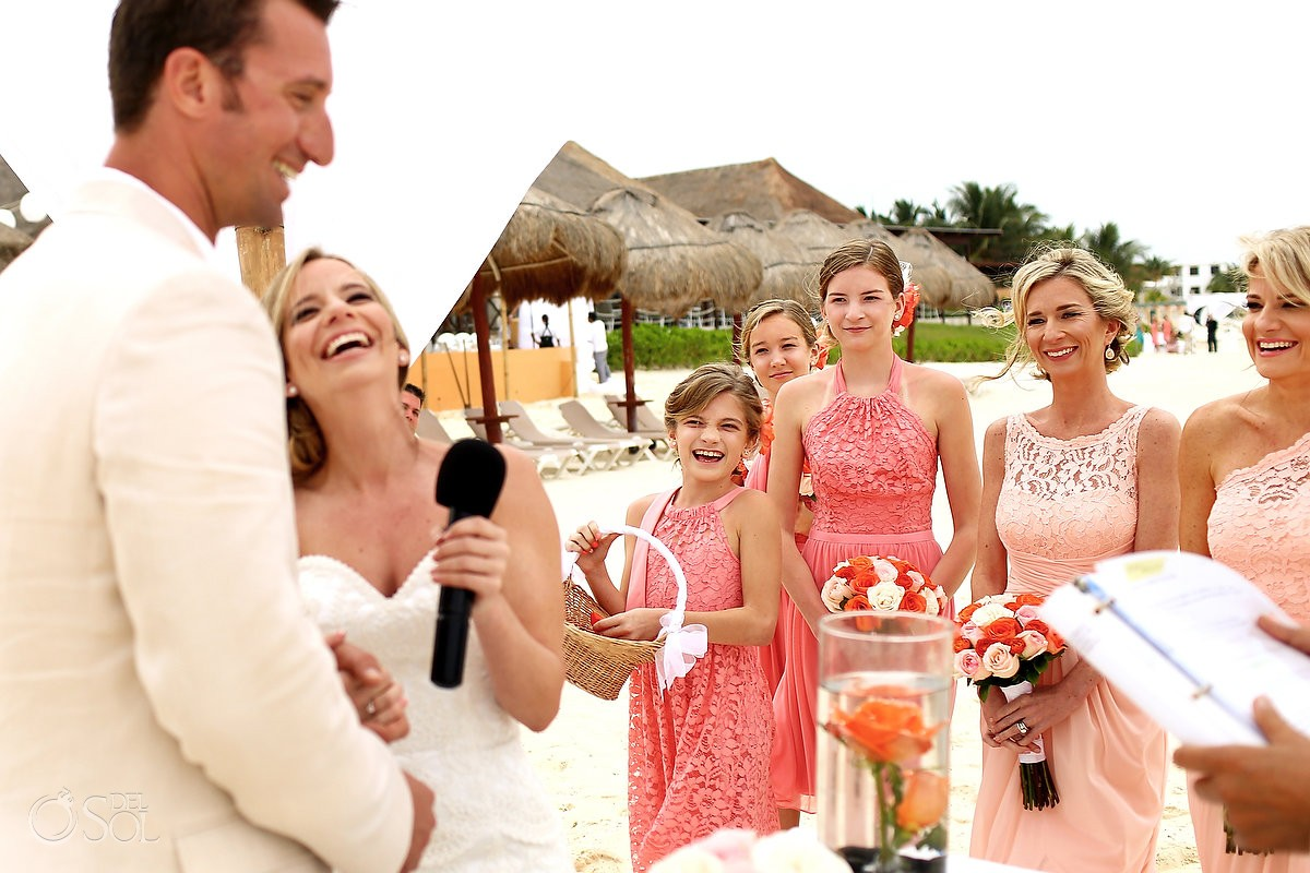 laughing happy beach wedding ceremony Now Sapphire