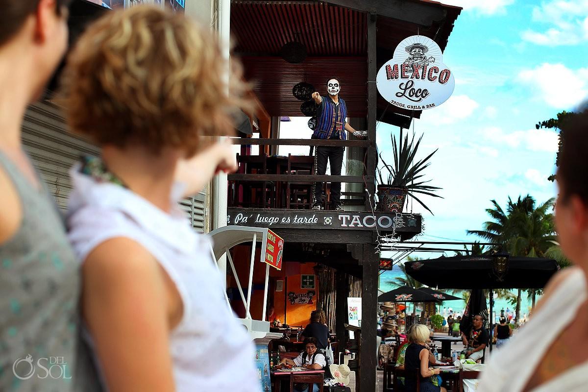 Playa del Carmen 5th avenue portrait street photography. Skull face paint taco restaurant