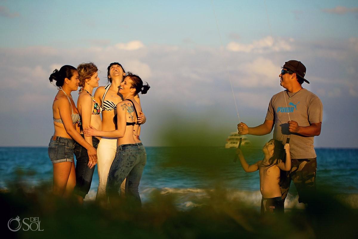 Playa del Carmen beach portraits cute kid flying kite beside ladies group