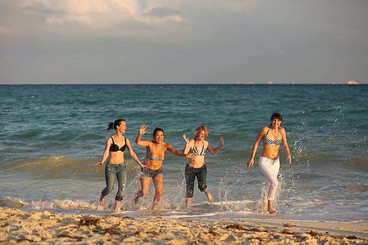 girls running on the beach playa del Carmen