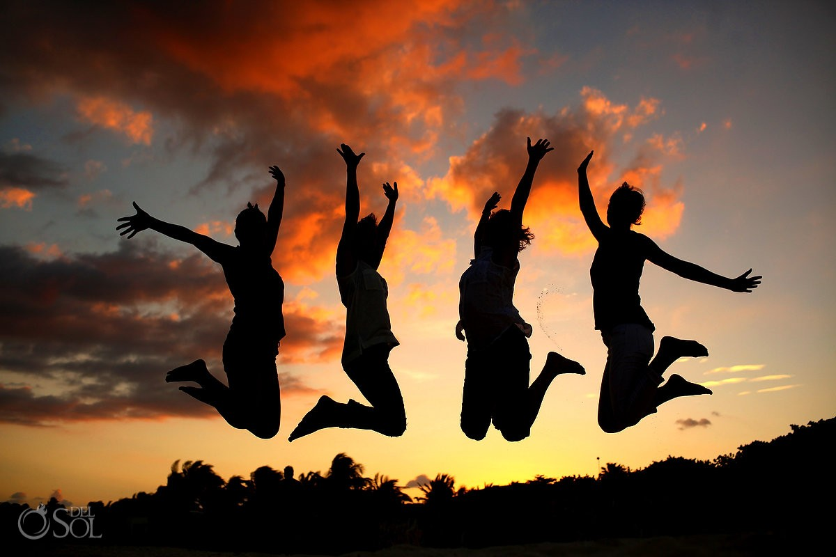 sunset silhouette four girls jumping. happy, fun, empowering friends portraits celebrating beauty strength women