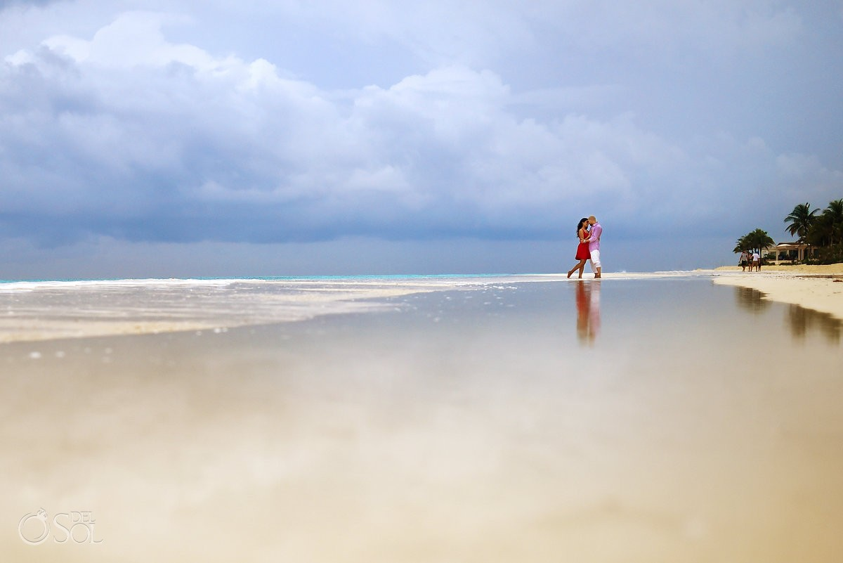 playa del carmen scenic beach portraits, couple kissing red dress reflection, rain blue ocean skies