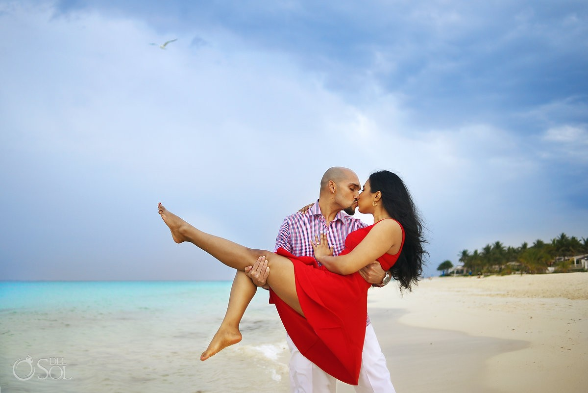 playa del carmen beach portraits, couple kissing red dress, rain blue ocean skies