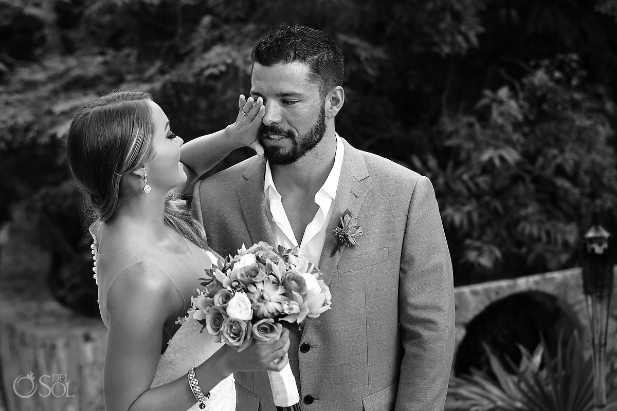 black white groom crying First look Xcaret Park wedding, Playa del Carmen, Mexico