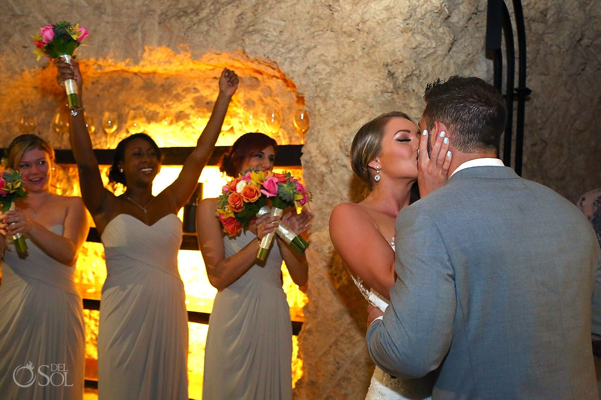 first kiss Xcaret rain plan B wine cellar wedding ceremony
