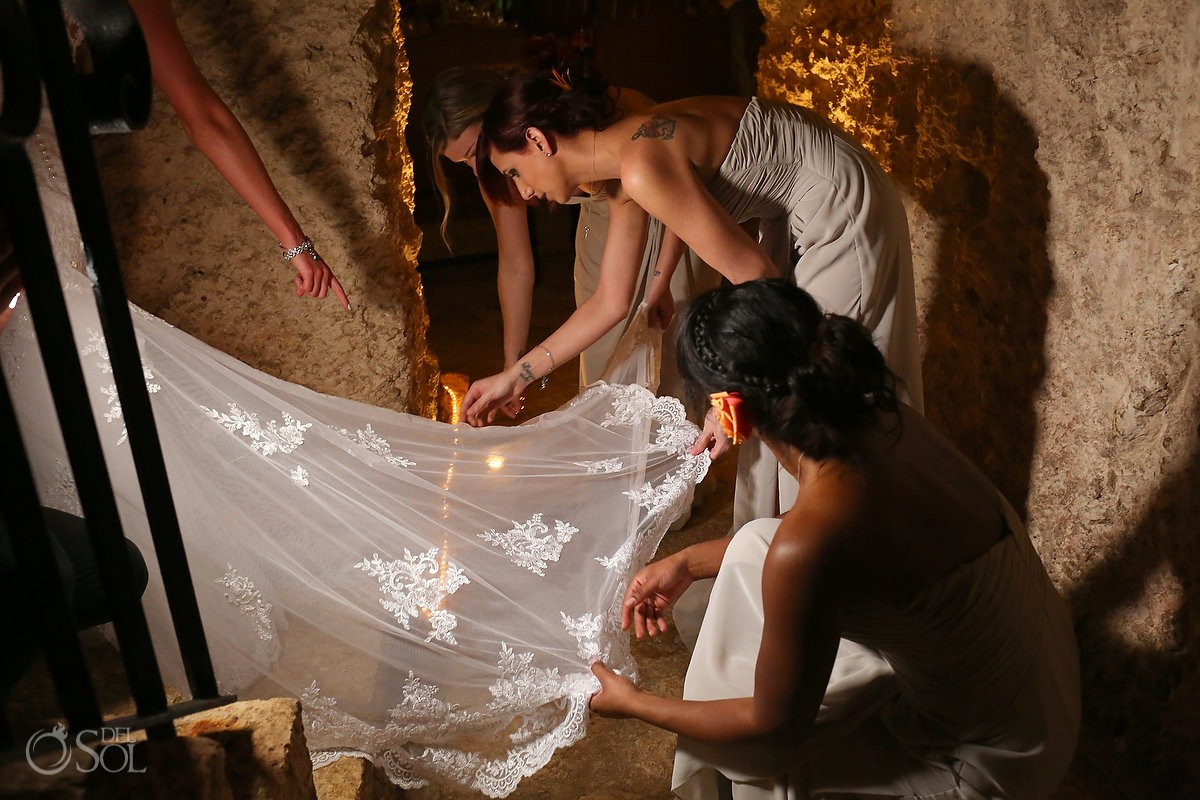 bridesmaids fixing Essense of Australia Wedding dress, Xcaret rain plan B wine cellar