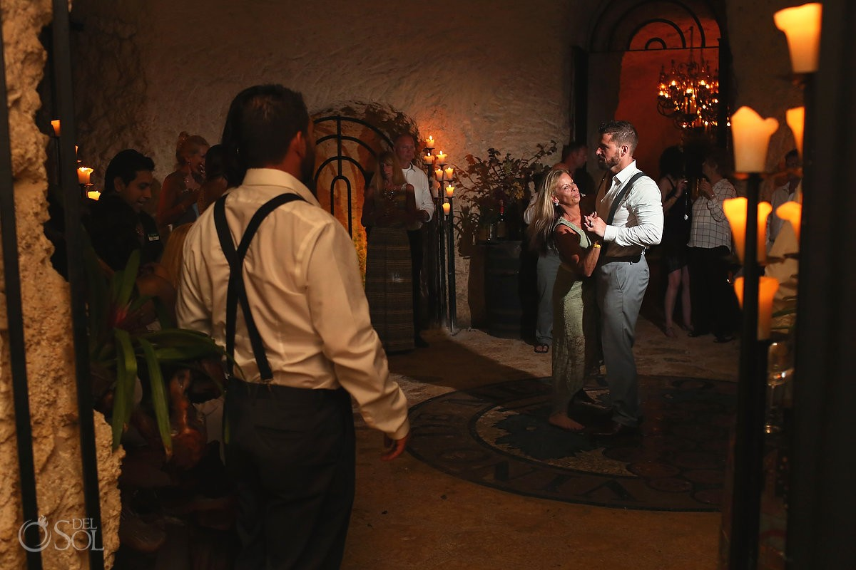 groom mother dance, rain wedding reception venue, wine cellar, xcaret