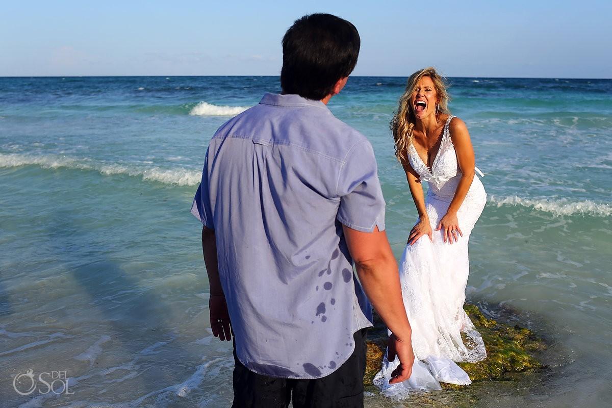 bride splashing water at xpu ha beach mexico