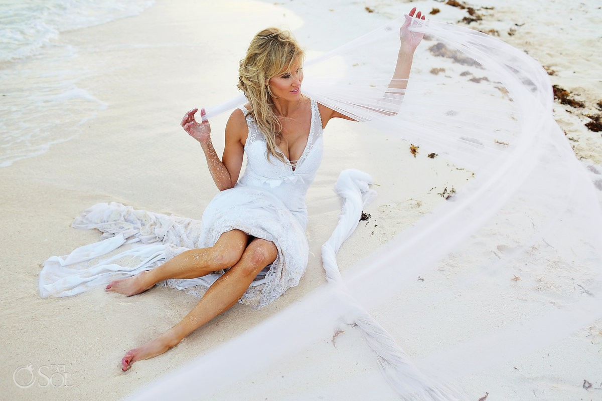 trash the dress photograph with bride on the beach in mexico