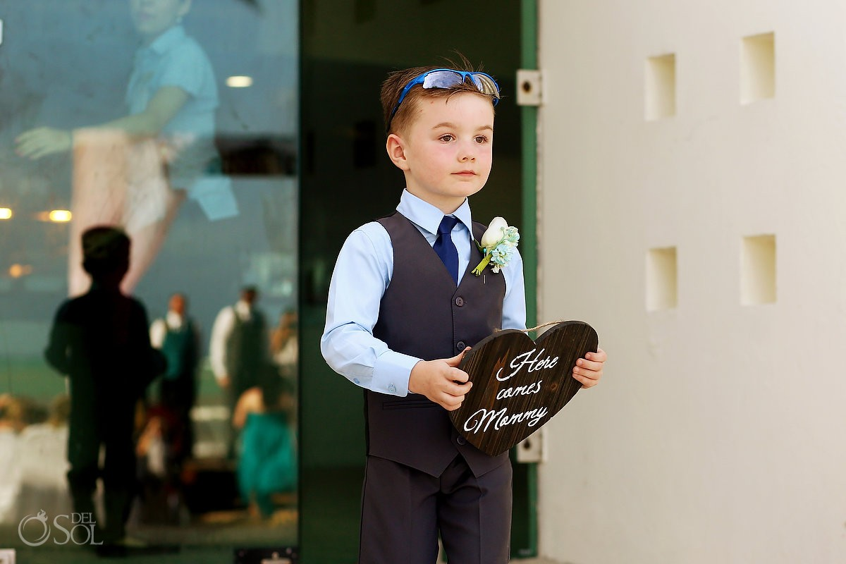 ring bearer holding 'here comes mummy' sign, beach Wedding Blue Bay Grand Esmeralda, Playa del Carmen, Mexico