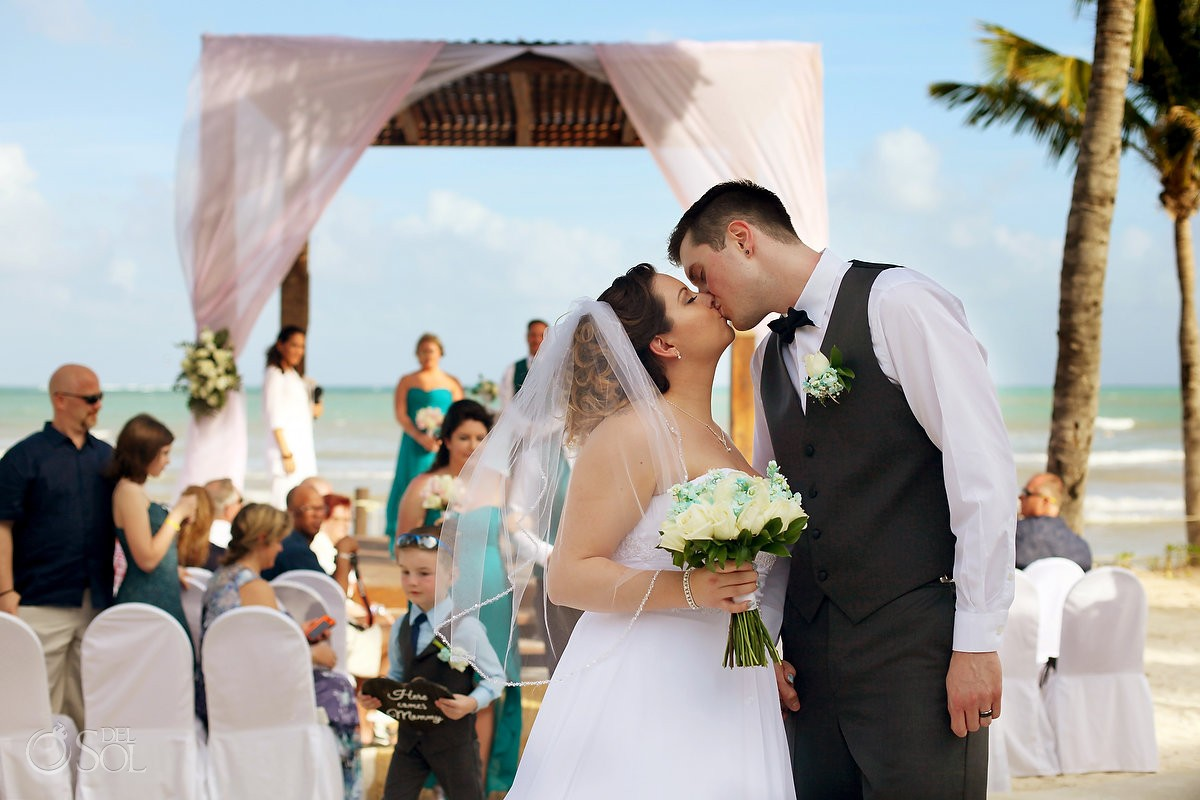couple kiss beach wedding BlueBay Grand Esmeralda, Playa del Carmen, Mexico